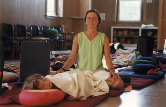 3 02 Mother and daughter share a meditative moment.